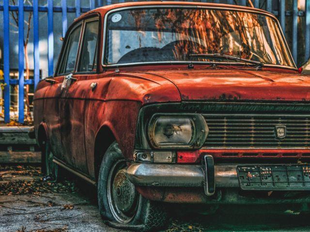 abandoned orange sedan 746684 scaled thegem blog justified - HOME - JUNK CARS